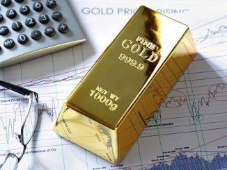 Gold bullion barr on a stocks and shares chart